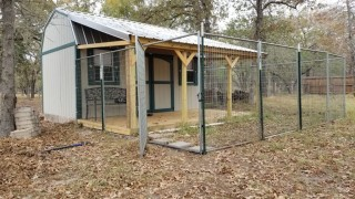 An the kennel is finished. Doggie door in and fencing in place